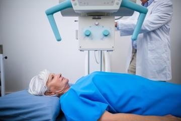 Senior woman undergoing x ray test in hospital