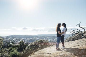 A couple kissing on the hill