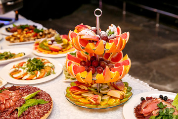 Beautifully decorated catering banquet table with fresh fruits on corporate birthday party,event or wedding celebration