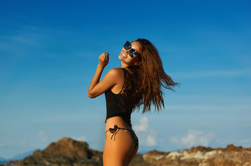 Photo of young beautiful smiling woman in summer beach clothes o