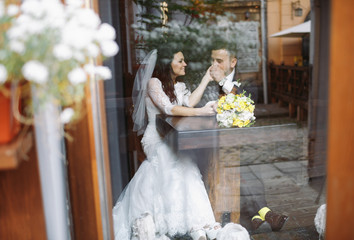Lovely moment of the newlyweds in the cafe