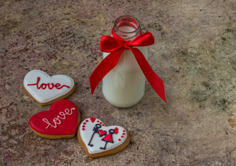 Cookies for Valentine's day and glass bottle of milk with red ri
