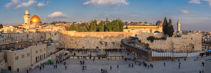Wall Murals Middle East Temple Mount panoramic view in the old city of Jerusalem at sunset, including the Western Wall and golden Dome of the Rock.