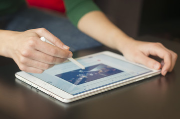 Woman Using Tablet With Smart Pen