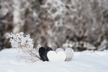 Valentines hearts on winter snow background. Valentines Day concept. Selective focus. Free space.