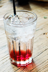 Sparkling cherry soda on wooden table