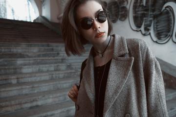 Beautiful and stylish girl in sunglasses