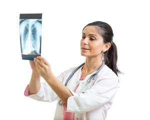 Young female doctor looking at the x-ray shot of lungs in hospital