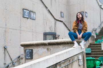 Teenager posing in an abandoned stadium Fototapete