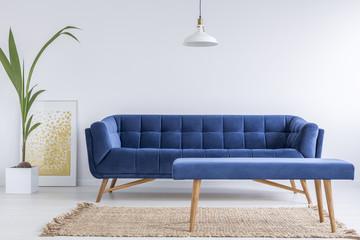 White apartment with blue sofa