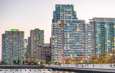 Lower Manhattan modern buildings lights at sunset