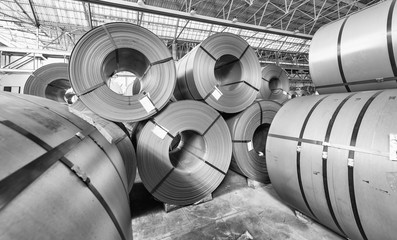 Metal coils stacked. Industrial environment