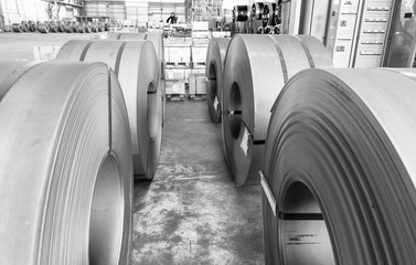 Metail coils stacked in a company warehouse