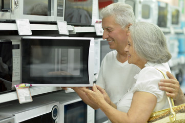 mature couple at electronics shop