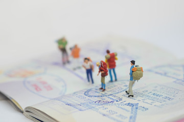 Miniature people with travelling concepts. Group of backpackers