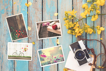 Retro camera and instant paper photo album of valentine day on wood table - photo of remembrance and nostalgia in spring. vintage style
