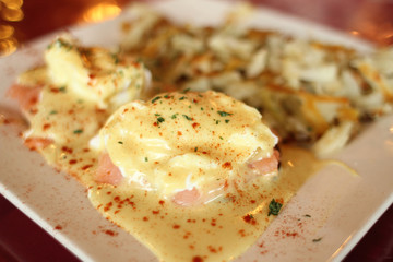 Salmon Eggs Benedict with potato hash.