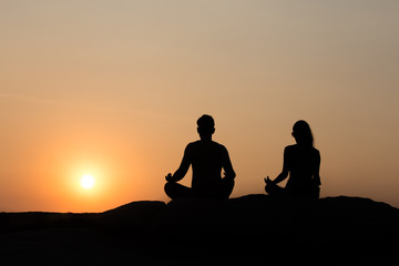 silhouette of couple at sunset summer, healthy concept