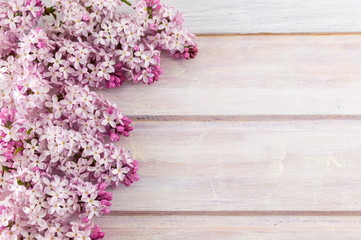 Purple lilac flowers on wooden table