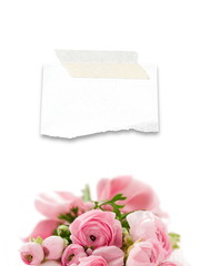 Blank ripped piece of paper frame with depth of focus pink flowers decoration
