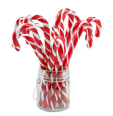 Candy canes in jar, on white background