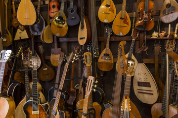 Foto op Textielframe Muziekwinkel musical instruments shop in warm orange and brown colors