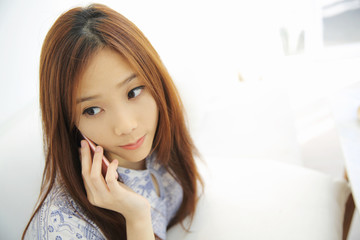 Asian young woman calling talking on phone callephohe in coffees