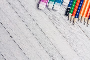 markers and pencils on a wooden background