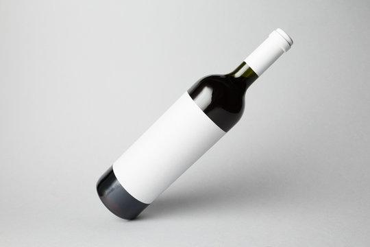 Slanted bottle on gray background