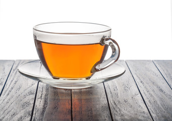 glass cup of tea on a wooden background