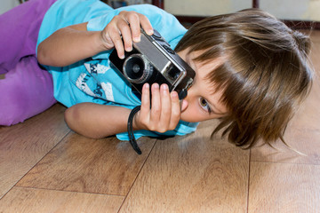 Young photographer looking at camera