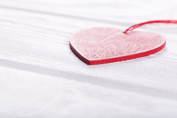 Heart on white wooden table
