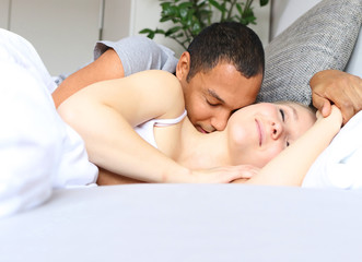 Waking up with a kiss - Man kissing sleeping woman
