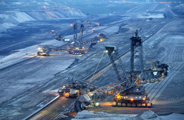 Large bucket wheel excavators in a lignite (brown-coal) mine after sunset, Germany