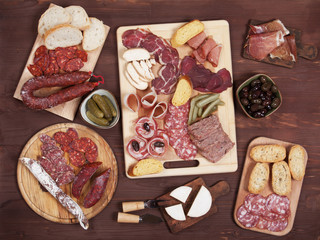 Charcuterie board with cured meat and olives