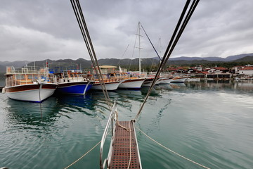 Tourist boats moored in the harbor. Uçagiz-Three mouths bay-Ly