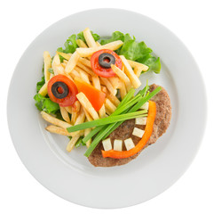 potato fries with vegetables in shape of funny face
