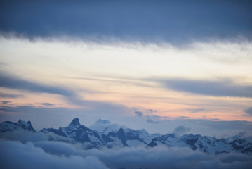 Caucasian mountain ridge, sunset sky and clouds
