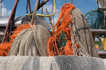 Close-up view on fishing nets in the old port of Oudeschild, Texel. Wall mural