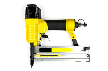 Yellow stapler pneumatic combi on a white background