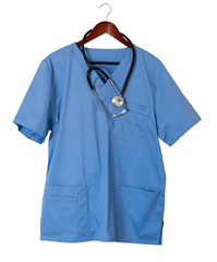 Blue scrubs shirt for medical professional hanging isolated