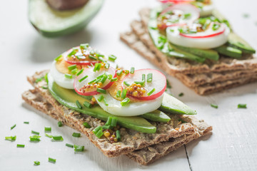Fresh sandwich with avocado, eggs and radish