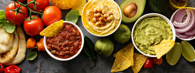 Homemade hummus, salsa and guacamole with corn chips Wall mural