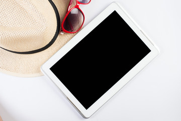 Top view of hat woman glasses and blank screen of tablet device