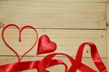 Design Red heart shaped ribbon and chocolate heart on old aged w