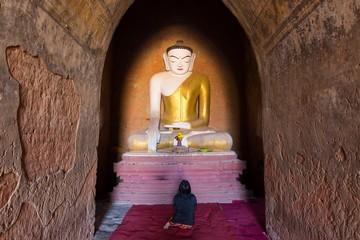 Burmese woman praying Buddha