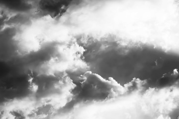 Bright Light and Storm clouds gathering.Black and White background.
