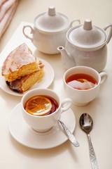 lemon cake with tea. Breakfast in bed. White background, white crockery