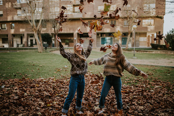 Friends throwing up the foliage
