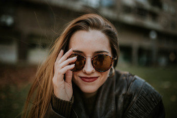 Cheerful lady in sunglasses